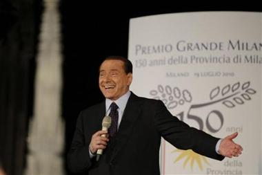 1031152638-italian-premier-silvio-berlusconi-delivers-his-speech-prior-to-be